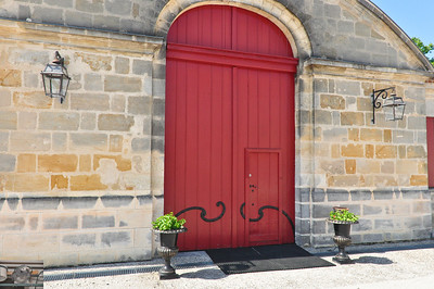 Warehouse door, Chateau Le Louviere, looks like the blacksmith was enjoying their product while working.