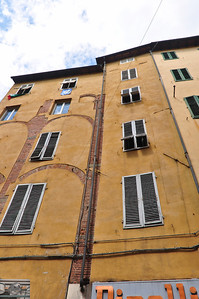 It seems you can't cover over 100% of the building and had to let some of the older bits remain visible (Lucca).