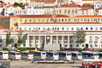 Old architecture and a herd of buses.