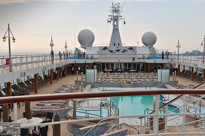Looking to the bow.  Pool bar is portside, the two hot tubs and the pool.