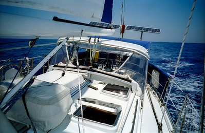 Sailing under autopilot.  Notice the solar panels generating the electricity to power the autopilot and other electrical devices.