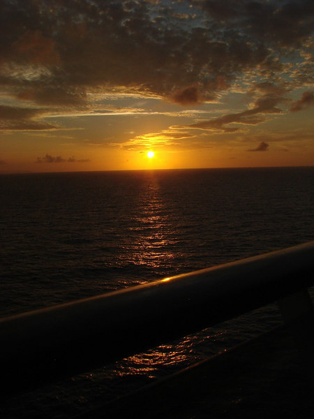 Sunset and Deck Rail in he Grand Bahamas Bank off Cuba