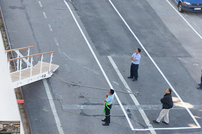 Workers waiting for the gangway to stow itself