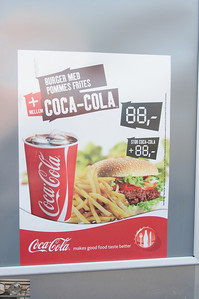 """I don't understand ads like this.  Why not have everything in the local language.  Also, how can the  """"Stor Coca-Cola"""" be both +88,- or is the ,- like .00?"""