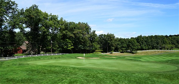 Hole #5 - the green, the fairway, the rambling white fence, the rustic farmhouse, all that good stuff