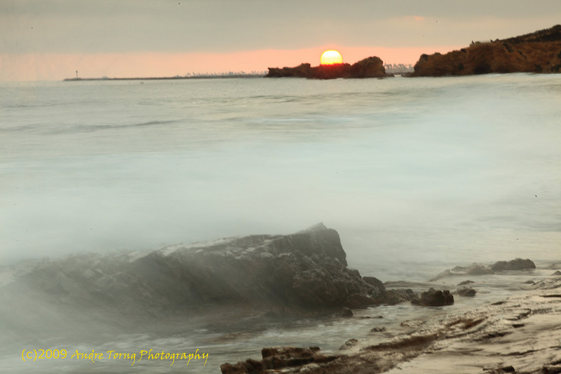 905-Andre-Sunset with wave covered rock