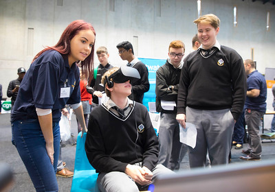 "09/11/2017. Crystal Valley Tech Showcase at WIT Arena. Pictured is Vincent Gornicki from St Kieran's College, Kilkenny with Claire Coppinger from Bluefin with a VR Head Set. Picture: Patrick Browne  Event demonstrates Tech and ICT is thriving in Kilkenny and the South East 50 companies and 2,000 students, industry and recruiters attend the inaugural Crystal Valley Tech Showcase event  Over 50 companies who are working together as Crystal Valley Tech showcased their rapidly growing industry in the WIT Arena on Thursday morning to approx. 2,000 members of the public, college and second level students, recruiters, government agencies and other industry.  The future is bright for ICT in the South East according to Dr Padraig Kirwan, Head of the Department of Computing & Mathematics at Waterford Institute of Technology. ""Computing is thriving in the South East judging by the number and diversity of ICT companies here today. Even more encouraging is the number of second level students who attended from Waterford, Kilkenny, Carlow, Tipperary and Wexford and how interested they are about the career opportunities in this exciting industry.""  Kilkenny schools attending the event included St Kieran's College,  VTOS Kilkenny and Presentation Secondary School in Loughboy.  Elaine Fennelly, Bluefin Payment Systems General Manager and co-founder of Crystal Valley Tech is very excited about the industry in the South East and today's showcase event. ""People who work in the industry already know that Tech is well established in the South East and the number of opportunities and companies continues to grow and grow. According to a recent Tech Ireland report there are over 60 indigenous and multinational companies employing well over 1,500 people from their bases in Waterford, Wexford, Kilkenny and Carlow.  ""However, we weren't so sure that people in the region realised just how big the ICT industry is becoming and to ensure the industry's future growth in the South Eas"