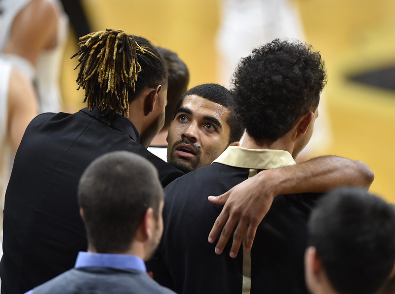 "Colorado's senior Xavier Talton hugs teammates after comes off the court during Sunday's Men's Basketball game against Arizona State at the University of Colorado's Coors Event Center.<br /> <br /> More photos:  <a href=""http://www.dailycamera.com"">http://www.dailycamera.com</a><br /> David R. Jennings/Staff Photographer<br /> February 28, 2016"