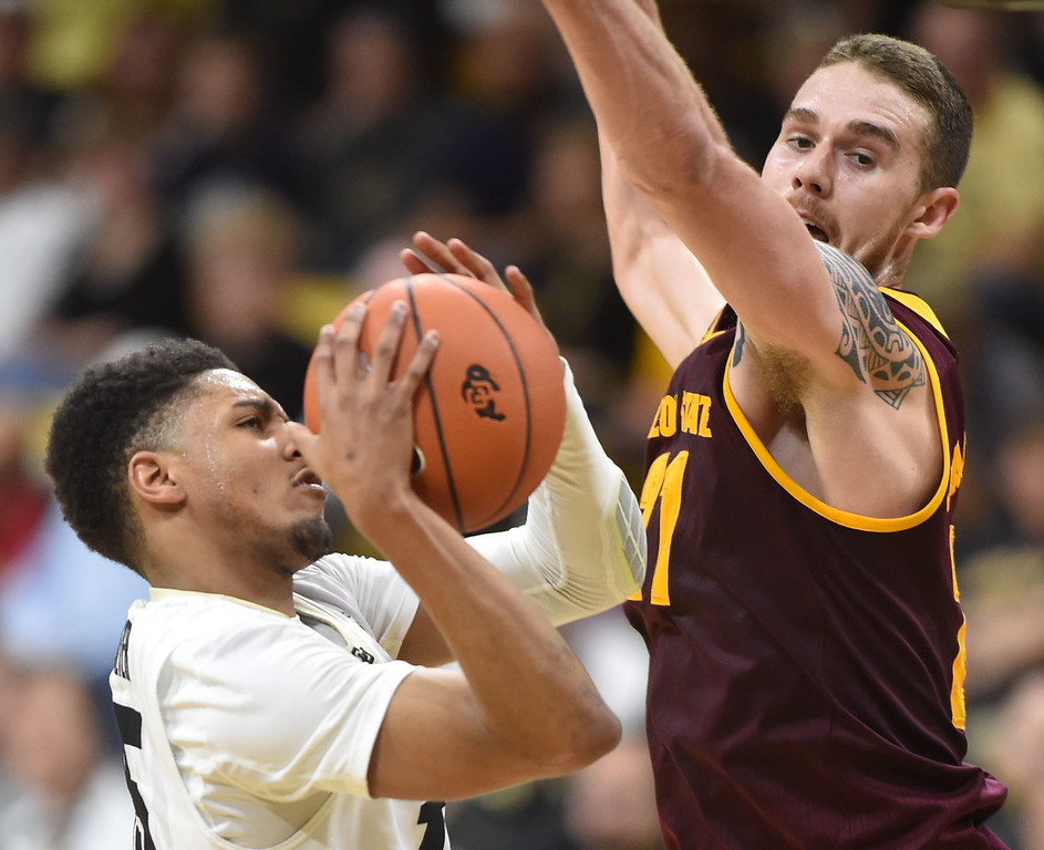 """Colorado's Dominique Collier goes to the basket against Arizona State's Eric Jacobsen during Sunday's Men's Basketball game at the University of Colorado's Coors Event Center.<br /> <br /> More photos:  <a href=""""http://www.dailycamera.com"""">http://www.dailycamera.com</a><br /> David R. Jennings/Staff Photographer<br /> February 28, 2016"""