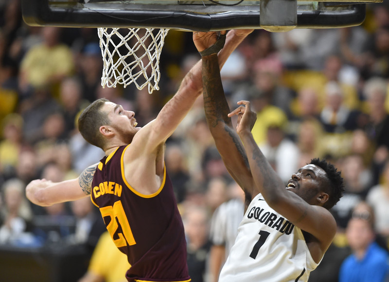 "Colorado's Thomas Akyazill goes to the basket against Arizona State's Eric Jacobsenduring Sunday's Men's Basketball game at the University of Colorado's Coors Event Center.<br /> <br /> More photos:  <a href=""http://www.dailycamera.com"">http://www.dailycamera.com</a><br /> David R. Jennings/Staff Photographer<br /> February 28, 2016"