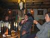 """La primera noche de vuelta en Cusco siempre hay que tomar unas cervezascon los amigos. En esta foto se ve Anabelly, Mario y César. <br /> Las cervezas o chelas como se dice acá son más grandes que en Europa, una botella de cerveza cuenta con 62 cly como la rubia belga tiene 5,2° de alcool.<br /> <br /> ¿El bar? La Carreta, un local no tan pequeño donde casi no llegan turistas y en un entorno bastante acogedor, con un buena música (no conozco ningún bar metalero en Cusco) y donde el barman o el DJ siempre nos guardan un buen sitio para pasar una buena noche entre amigos. <br /> ¿Fútbol en la tele? Nos reservan la mesa redonda donde estamos en la foto, la mejor mesa para ver la tele. <br /> <br /> ¿Nada especial esta noche? Nos reservan el lugarque suelo llamar """"palco el honor"""" que en realidad son tres sillas y una mesa redonda en una pequeña plataforma al lado de la barra donde se ve casi todo el bar y lamentablemente también la tele. Me gusta ir a bares donde no hay teles, tampoco me gusta ir a comer algo bueno en un restaurante con teles pero serán costumbres locales y yo soy el gringo/guiri. <br /> <br /> A diferencia de muchos otros bares cerca de la Plaza de Armas aquí casi no llegan extranjeros, sólo la gentita local, mayormente la clase media del Cuzco.<br /> <br /> La Carreta - C/. Heladeros - Cusco - Perú<br /> Lunes, 13 de agosto '12"""