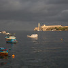 The Malecon faces El Morro, a Spanish colonial fortification protecting Havana Bay