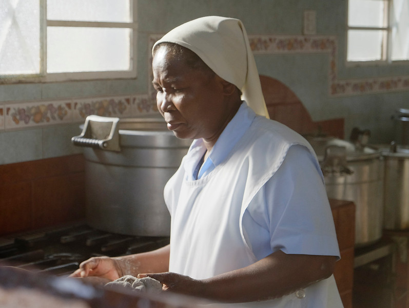 One of the nuns preparing a meal in the hospital kitchen