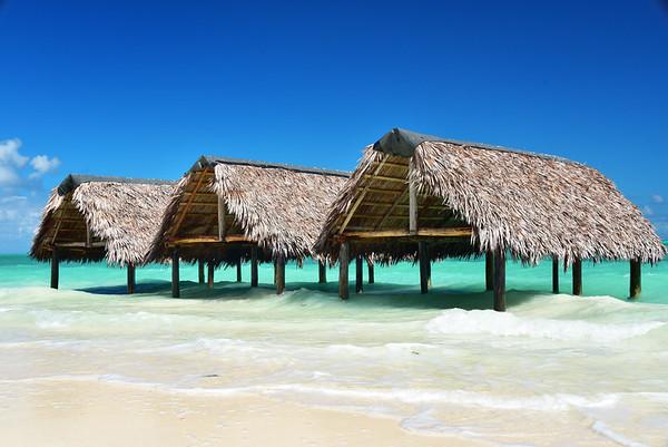 Three huts on shore