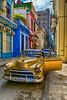 Gold Car in Old Street in Havana