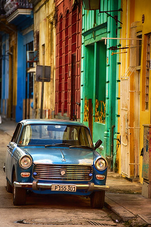 Blue car in colorful street