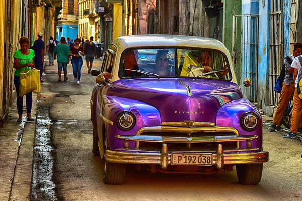Purple car down street