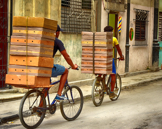 Guys with boxes on Bikes