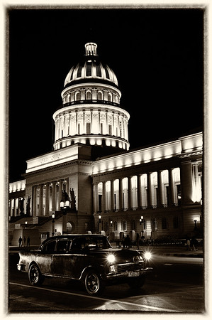 Taxi with headlights and Capitolio building in behind B&W