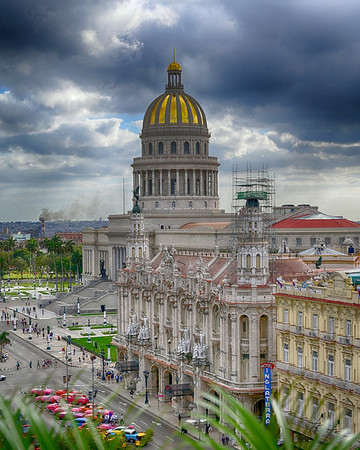 Capitolio and Old building with cars