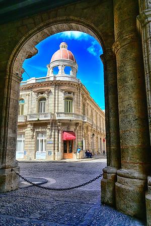 Well framed Building thru arch