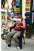 Cuban man reading paper