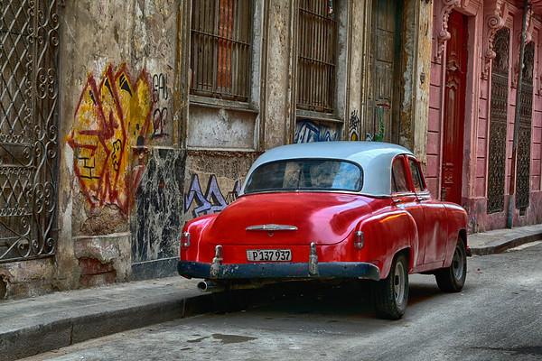 Orange car and grafitti