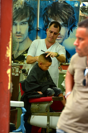 One busy barber with Boy