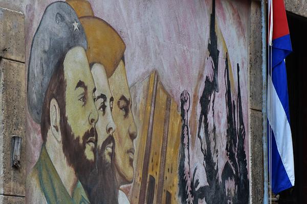 Mural of men and Flag