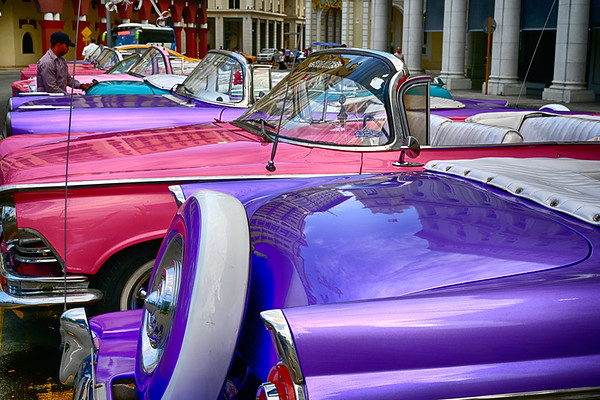 Colorful row of Old Cars