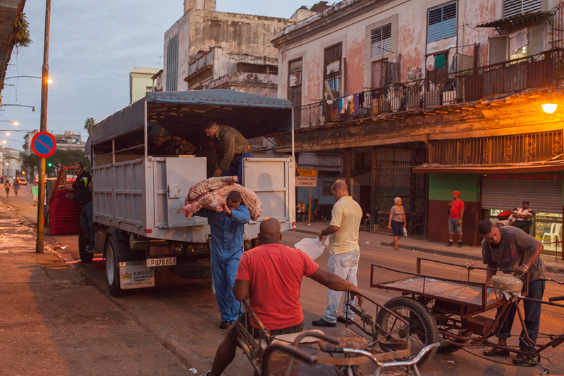 Unloading meat for a market.