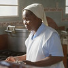 Nun preparing meal at the leper facility