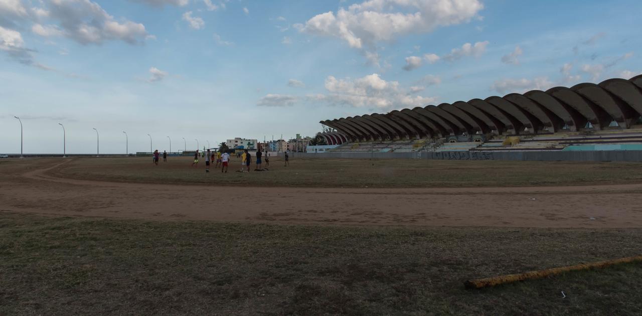 Soccer game in abandoned stadium.