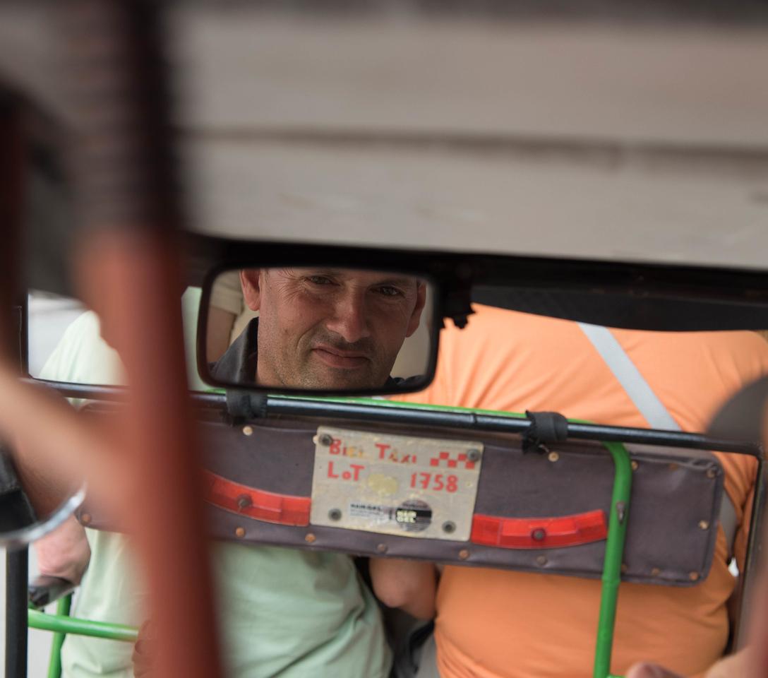 Tuk Tuk driver in his reare view mirror