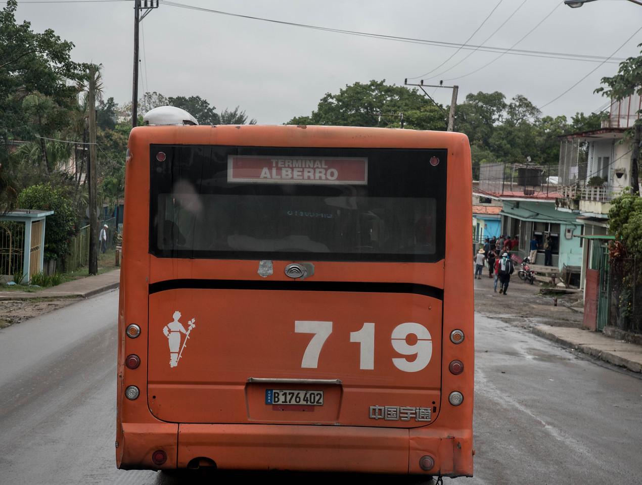 Behind a bus