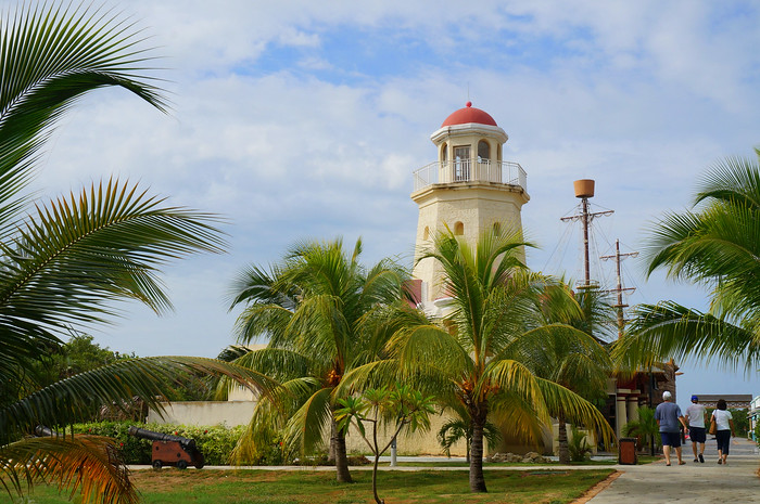 Lighthouse and palm trees.
