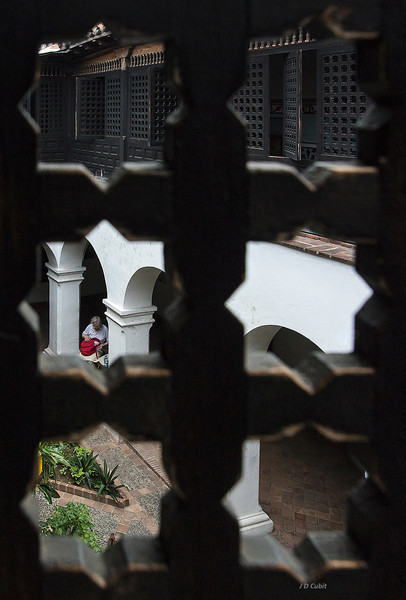 The courtyard-patio of the Diego Velazquez house in Santiago de Cuba, viewed through the Moorish-Andalusian style lattice work on the second story.  This is thought to be the oldest extant house in Cuba.