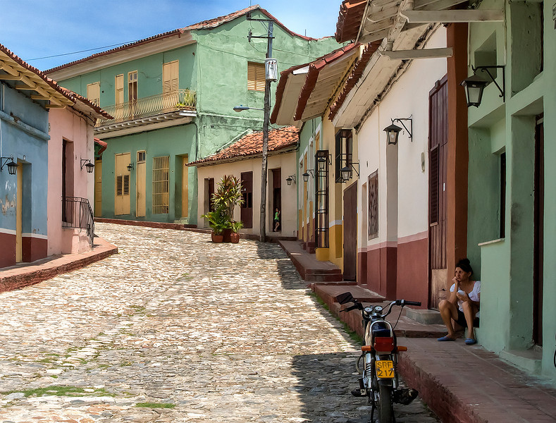 Sad faced woman on a quiet street in Sancti Spiritus, Cuba.