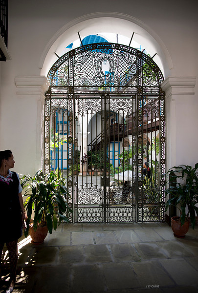 Beautiful Andalusian-Moorish foyers with arched entryways into sunlit patios are common in Cuba.  This one in Old Havana has been recently restored.