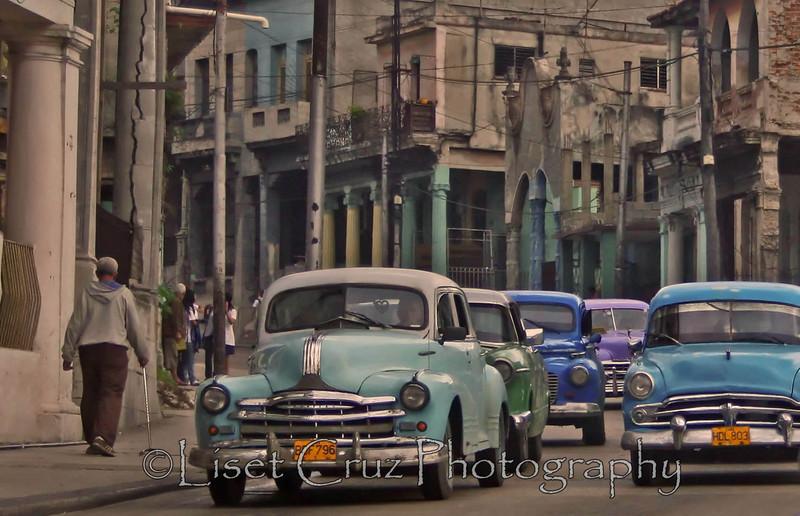 """Boteros"" are old American cars that function as taxis in Cuba. 10 de Octubre Avenue. Havana, Cuba."