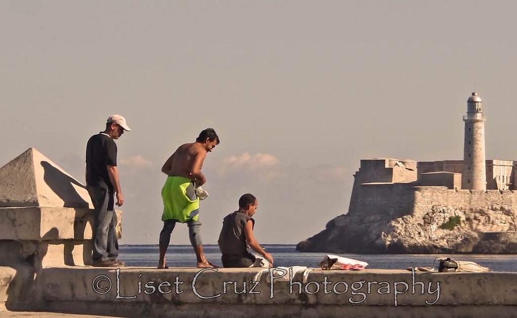 Men fishing in the Malecon. Havana, Cuba.