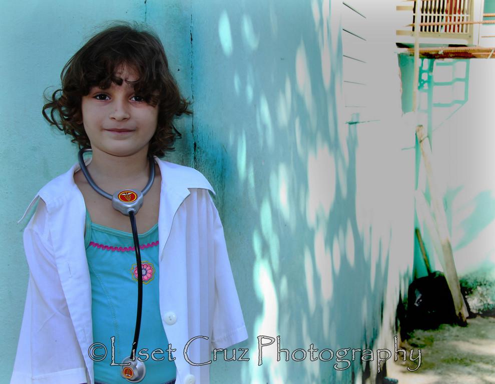Girl in Havana dressed as a doctor.  Havana, Cuba.