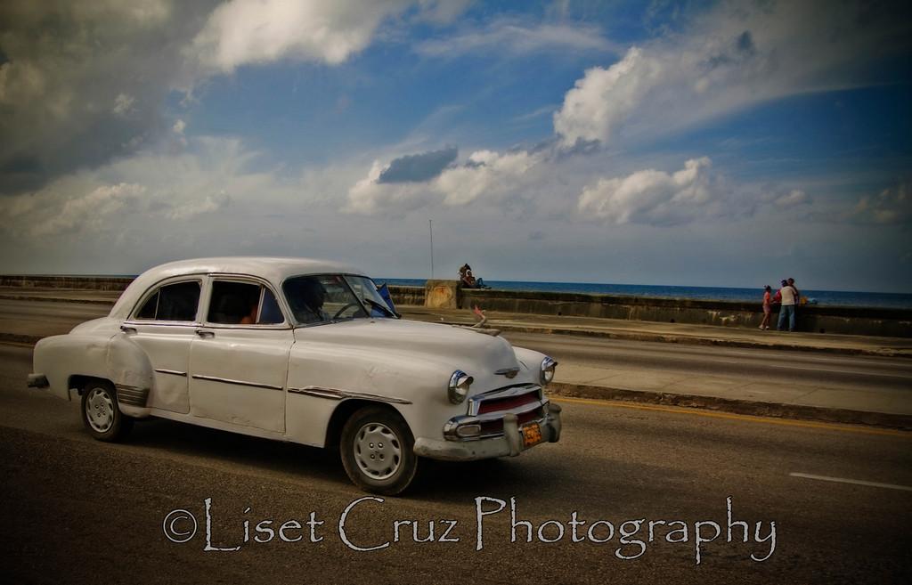 Old American car in the Malecon.  Havana, Cuba.