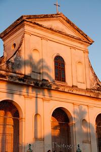 The shadow of a Royal palm on the church's facade in Trinidad, Cuba.