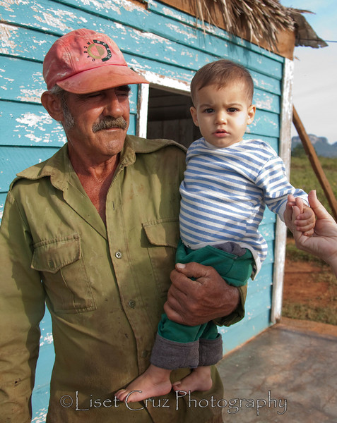 A grandfather looks at his grandson with pride.