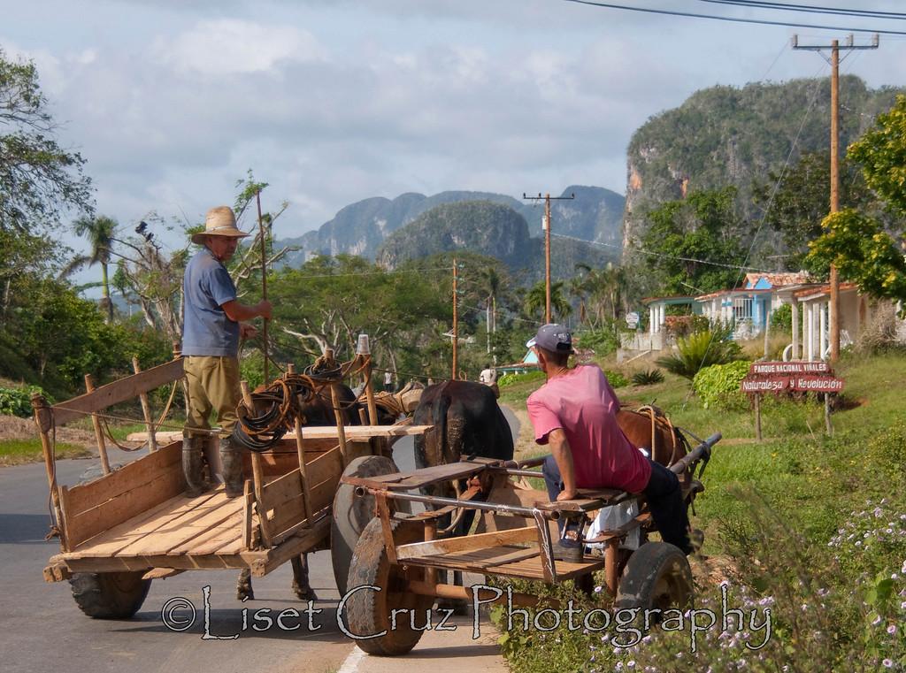 Men stop to chat in Viñales, Pinar del Rio, Cuba.