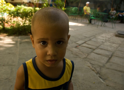 Child interested in the camera, Havana