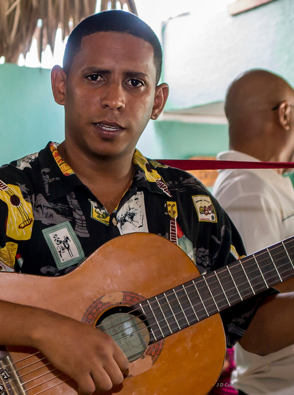 "Note the use of the standard Spanish guitar instead of the traditional ""tres"" guitar of Changui that has the six strings grouped in three pairs."