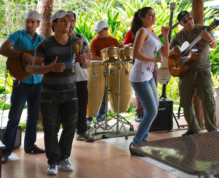 Contemporary Cuban band playing at a roadside area in the countryside.