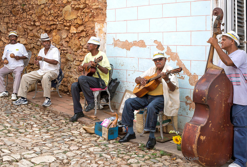 Cuban band on a cobblestone street in Trinidad de Cuba.
